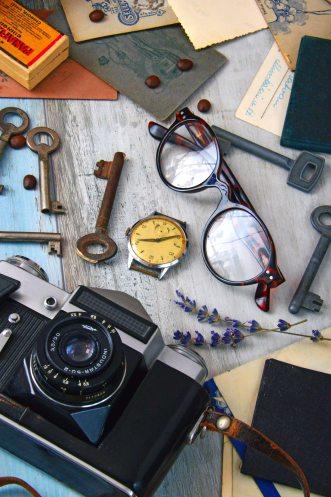 round-brown-framed-eyeglasses-near-black-camera-1416865